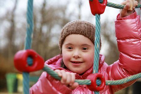 Photo pour Portrait of beautiful girl on the playground - image libre de droit
