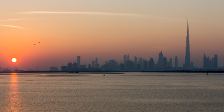 view of Dubai skyscraper and Burj Khalifa at sunset United Arab Emirates UAE