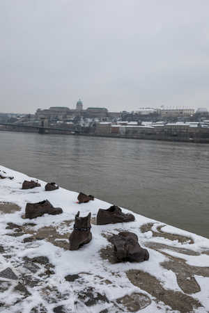 Photo for Shoes on the Danube Bank Memorial in Budapest Hungary at winter time - Royalty Free Image