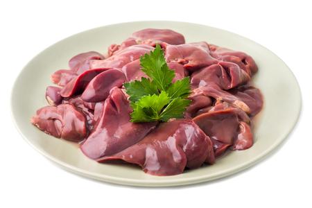 Foto de Fresh raw chicken liver on a plate. Isolated on white. - Imagen libre de derechos