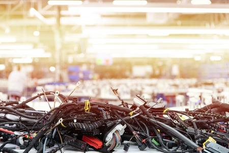 Photo pour Manufacturing of wiring harnesses, automotive industry, technology - image libre de droit