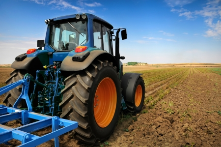 Photo pour The Tractor - modern farm equipment in field  - image libre de droit