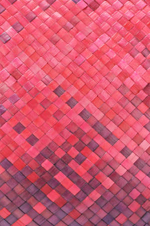 Close up of colored woven palm leaves mat background