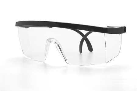 Plastic safety goggles on white background