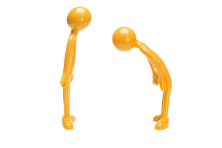Toy rubber figurine bowing to another on white background