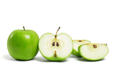 Whole fresh green apple and sliced pieces on white background