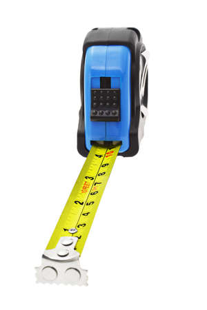Close up of extended measuring tape with magnetic head in metric and imperial units