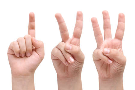 Child hands showing one, two and three fingers