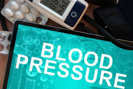 Tablet with the words  blood pressure and Electronic blood pressure monitor