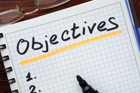 Objectives concept  written in a notebook
