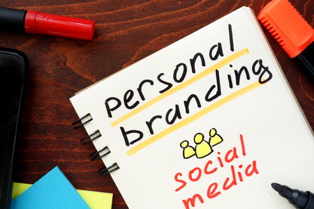 Personal Branding written in a notebook. Social media concept.