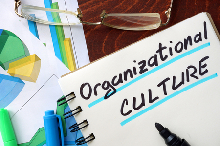 Organizational Culture written in a notepad. Business concept.