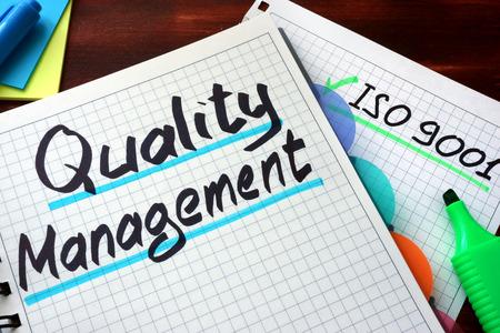Foto für Key Performance Indicators KPI written on a notepad with marker. Quality Management System QMS written on a notepad with marker. - Lizenzfreies Bild