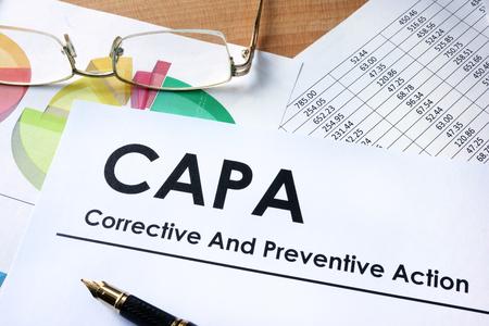 Photo pour Paper with words CAPA Corrective and Preventive action plans - image libre de droit