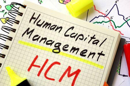 Photo pour Sign human capital management HCM on a page of notebook. - image libre de droit