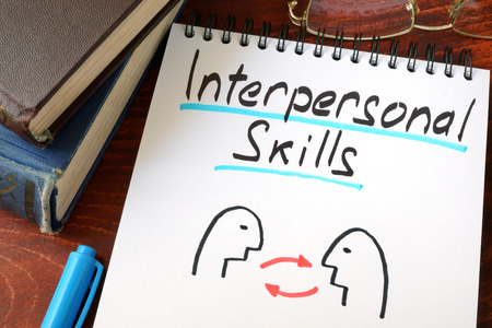 Photo pour Interpersonal Skills written in a paper with a glasses. - image libre de droit