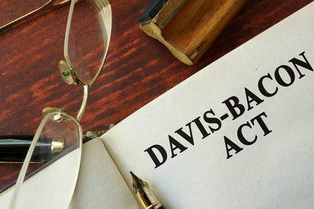 The Davis-Bacon Act written on a page.