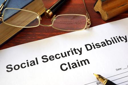 Photo pour Social security disability claim on a wooden table. - image libre de droit