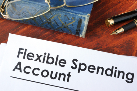 Photo for Papers with flexible spending account FSA on a table. - Royalty Free Image