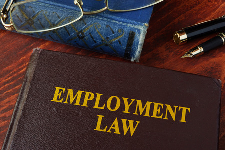 Photo for Book with title employment law on a table. - Royalty Free Image