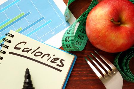 Photo pour Calories written in a diary. Calorie counting concept. - image libre de droit