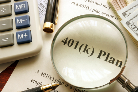 Document with title 401k plan on a table.