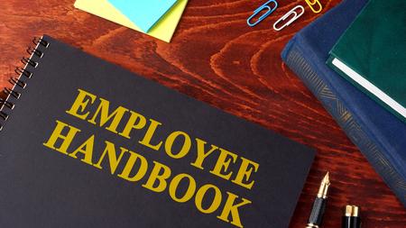 Photo pour Employee Handbook or manual in a office. - image libre de droit