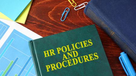 Photo pour Book with title HR policies and procedures on a table. - image libre de droit