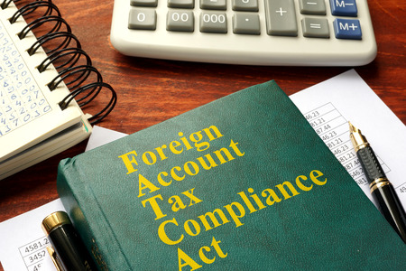 FATCA  Foreign Account Tax Compliance Act on a table.
