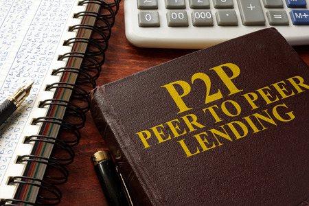 Book with title P2P peer to peer lending on a table.