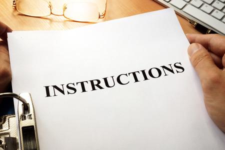 Photo pour Instructions in a blue folder. Guidebook concept. - image libre de droit