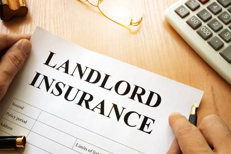Photo pour Landlord insurance on a desk. - image libre de droit