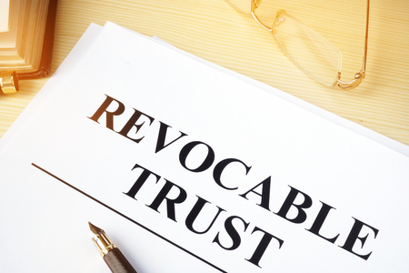 Photo for Revocable trust on a wooden desk. - Royalty Free Image