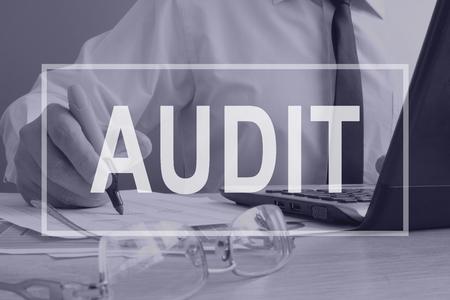 Photo pour Audit concept. Auditor is working with ledger. - image libre de droit
