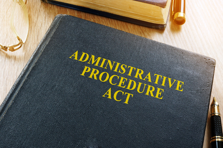 The Administrative Procedure Act (APA) on a desk.