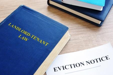 Photo pour Landlord-Tenant Law and eviction notice on a desk. - image libre de droit
