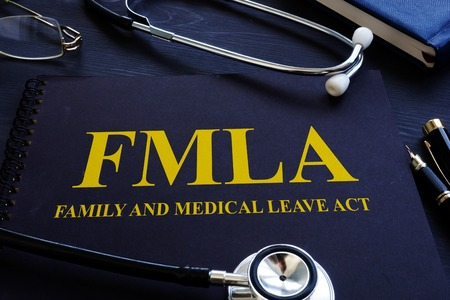 Foto per FMLA family and medical leave act and stethoscope. - Immagine Royalty Free