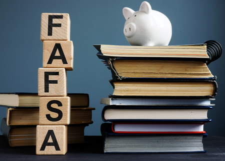 Photo pour FAFSA Free application for federal student aid. Letters on the cubes. - image libre de droit