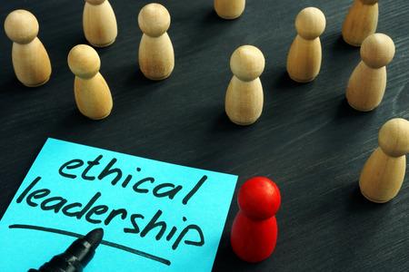 Photo pour Ethical leadership. Wooden figures on a desk. - image libre de droit