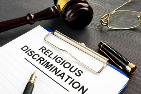 Photo pour Religious Discrimination claim and pen on a table. - image libre de droit
