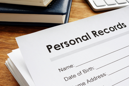 Foto de Personal records on a table. Privacy data. - Imagen libre de derechos