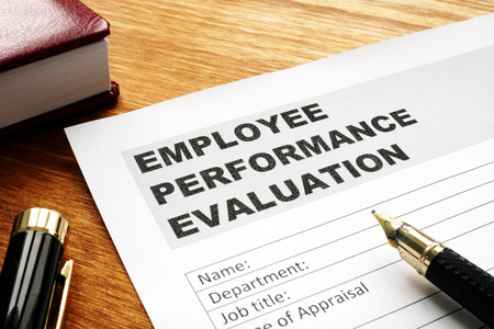 Photo for Employee performance evaluation form on a desk. - Royalty Free Image