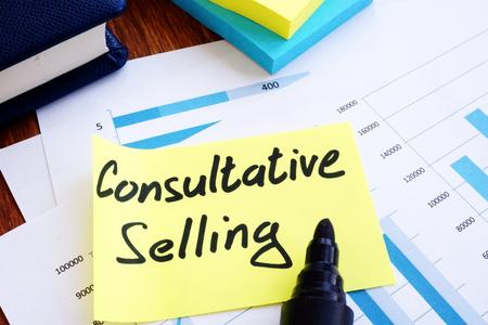 Photo pour Consultative Selling. Business reports and pen. - image libre de droit