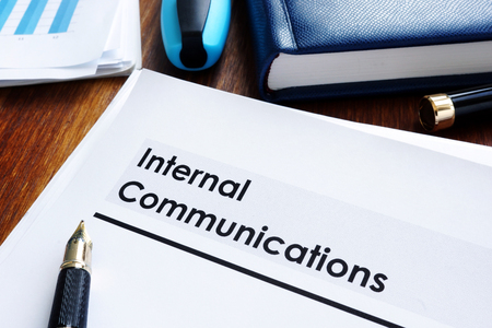 Photo pour Stack of internal communications documents on a table. - image libre de droit