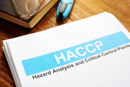 Photo pour HACCP Hazard Analysis and Critical Control Points report on table. - image libre de droit