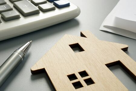 Foto für Property worth concept. Wooden model and calculator. - Lizenzfreies Bild