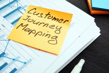 Photo pour Customer journey mapping. Stack of papers with report. - image libre de droit