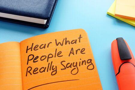 Photo pour Hear what people are really saying sign. Active listening technique concept. - image libre de droit
