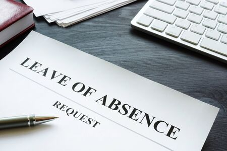 Foto de Leave of absence request on the table. - Imagen libre de derechos