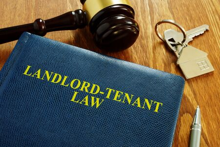 Photo pour Landlord Tenant Law book and key from home. - image libre de droit